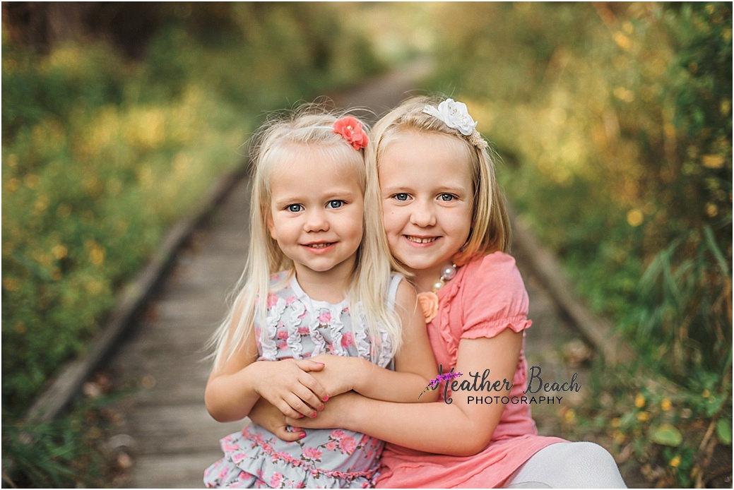 girl, sisters, siblings, 2 year old, 5 year old, Sun Prairie portrait photographer, Sun Prairie child photographer, Madison child photographer, boardwalk, sunset, gold hour, stool