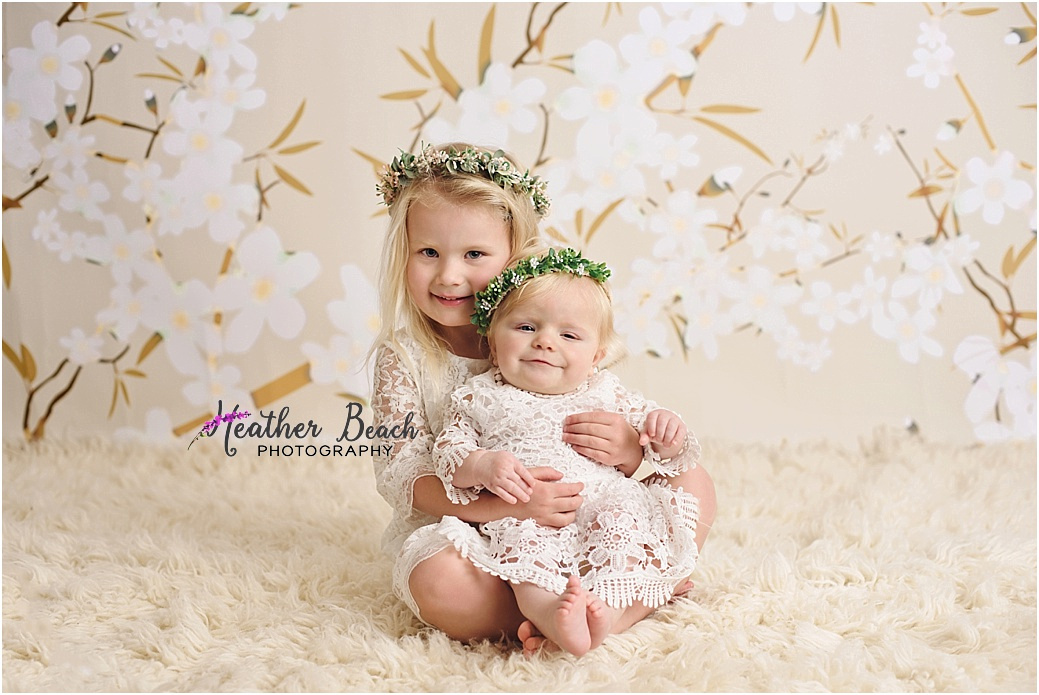 Sun Prairie baby photographer, Sun Prairie child photographer, Sun Prairie portrait photographer, Madison baby photographer, studio photos, flash photography, baby photos in Sun Prairie studio, cradle, dresses, bucket, sisters, two sisters in studio photography