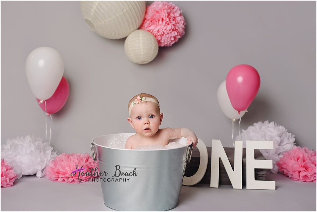 Sun Prairie baby photographer, Madison baby photographer, baby girl, bench, one year old, cute baby, smash and splash, cake smash, bubble bath, wood