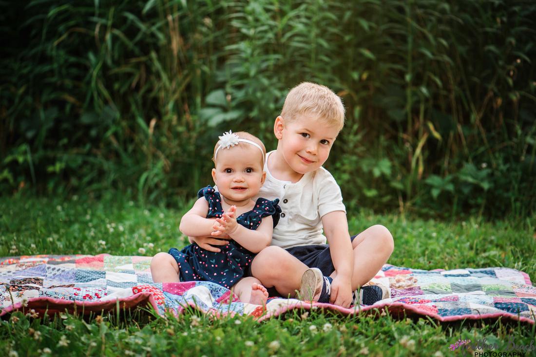 Spring in Wisconsin, spring blooms, Sun Prairie family photographer, Sun Prairie child photographer, family photography, Wisconsin photography, Madison photographer, siblings, kids, girls, family.