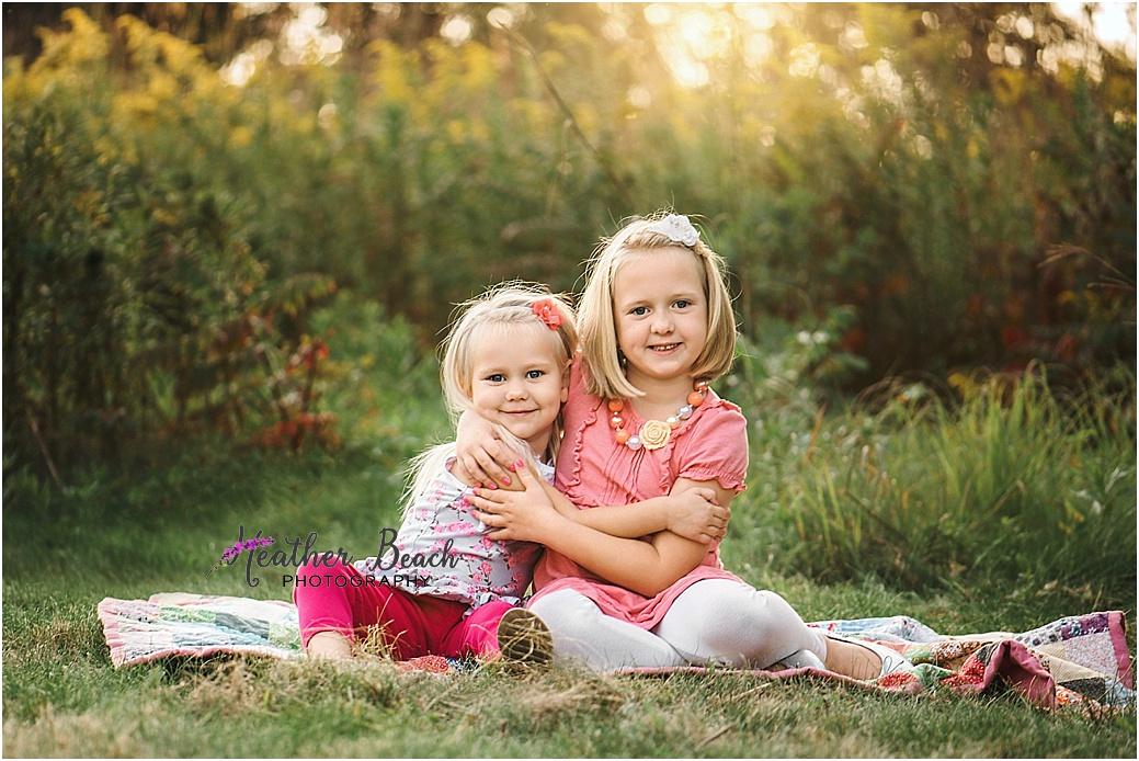 girl, sisters, siblings, 2 year old, 5 year old, Sun Prairie portrait photographer, Sun Prairie child photographer, Madison child photographer, boardwalk, sunset, gold hour, stool