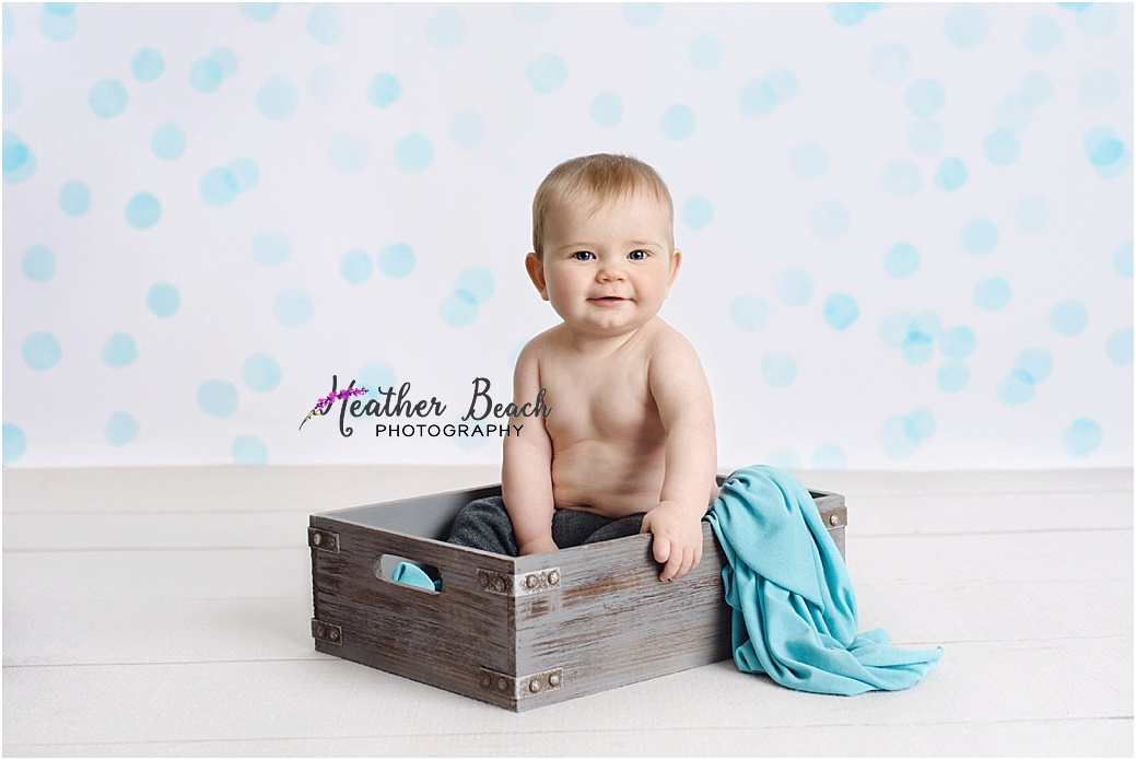 baby boy, 6 month old, Sun Prairie baby photographer, Madison baby photographer, Sun Prairie portrait photographer, Sun Prairie child photographer, wood floor, chair, crate, blankets, 6 month photos, cute baby photos